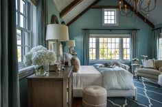 Large windows and French doors flood the master bedroom in natural light and offer sensational views of the breathtaking landscape surrounding this Cape Cod home.