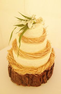 Rustic buttercream wedding cake with fresh flowers by Flossie Pops Cakery www.flossiepopscakery.co.uk