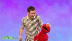 Elmo and Jimmy Fallon are enjoying a dance party. Hope you get out and about this weekend too!