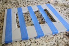 Easy striped picture frame from Shanty 2 Chic. Make these and put a family picture in it. Great gift...