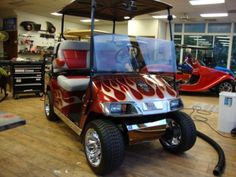 Infernio Red with custom painted flames, El Tiger Seats, Cragar mag wheels, low profile tires Ford Mustang Car, Ford Mustangs, Custom Golf Carts, Golf Cart Batteries, Optima Battery, Car Cleaning Hacks, Rusty Cars, Clean Your Car, Lead Acid Battery