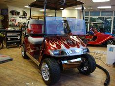 Infernio Red with custom painted flames, El Tiger Seats, Cragar mag wheels, low profile tires