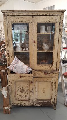 Back up for sale, this beautiful Antique Primitive chippy Cabinet from the late 1800's. A farmhouse in Missouri. Great chippy paint, sealed to perfection. Available on our website. We deliver to any state!