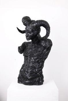 "Artist: Yong Ho Ji.  Work: ""Hybrid Sheep Man"" .  Made with Recycled Tires"