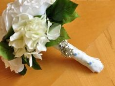 Instructions on how to make your wedding bouquet special by wrapping a handkerchief around the handle. Use a vintage hankie for your something old or a new and blue one for your something blue. Great idea from bumblebeelinens.com