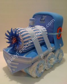 Adorable Train Diaper Cake for Boy / Girl / Neutral - Baby shower Centerpiece or gift for new baby. $92.00, via Etsy.