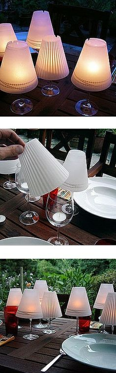 Outdoor table lamps made with stemmed water glasses, tea lights and mini lamp shades (For the lamp shades could I use fancier plastic cups with the bottoms cut out?)