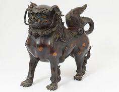 PATINATED BRONZE BUDDHIST FU LION -  Chinese. Early 18th Century.