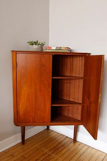 Danish Modern Corner Cabinet Clad In Teak Excellent Vintage Condition This Has Beautiful Brass Skeleton Key Holes That Lock The