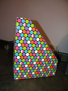 Duct tape covered cardboard magazine files for student book boxes.