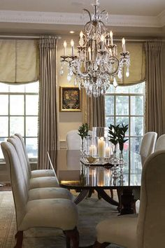 I like the window treatment, the candles on the silver platter and the art between the windows. And of course the crystal chandelier.