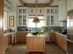 lovely kitchen, mix white with wood