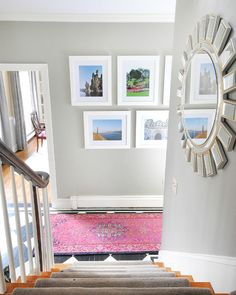 Vacation photos make a gallery wall in the hallway - affordable custom framing for a gallery wall