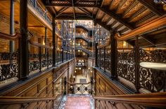 (Lewis) Bradbury Building in Los Angeles, built in 1893 by George Wyman. Since 1977 it is a National Historic Landmark Bradbury Building, Glazed Brick, Wood Railing, Central Business District, Interior Stairs, Beautiful Buildings, Architecture Details, Famous Architecture, Beautiful Architecture