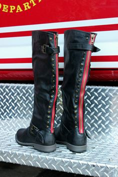 Become your own legend with these knee-high faux leather boots. It features a rounded boot-style toe with decorative studding along the back plastic zipper clos