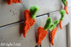 knit carrot garland for Easter from..so darling!