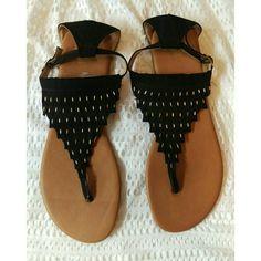 Black & Gold Ankle Strap Flat Sandals T-Strap NEW Black & gold ankle strap sandals. Flat, New, Never worn. Excellent condition. Report Shoes Sandals