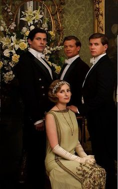Edith, Thomas, Jimmy and Tom | Downton Abbey - interesting subjects to picture together...but I like how they portrayed them. Tom's hand is on Edith's shoulder or at least on her chair and the footmen's hands are by their sides. He's family, they're not.