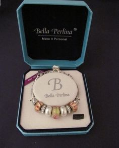 The enchantment and timeless beauty of Bella Perlina charm bracelets is displayed in this feminine soft hued mint and strawberry sorbet blend of feminine wrist luxury.   #stuff4uand4u