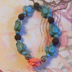 Cute Beaded Bracelet with Aqua Sea Turtles, Lava Beads and Orange Rose by ambiesbeadboutique on Etsy
