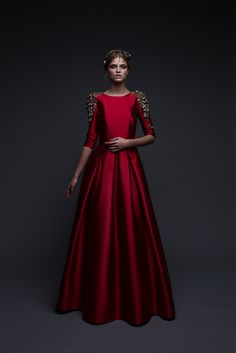 Red heavy silk ball-gown with metallic embellished shoulders and brown sea shells