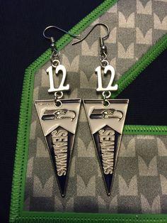 A personal favorite from my Etsy shop https://www.etsy.com/listing/472252607/seattle-seahawks-silver-12-fan