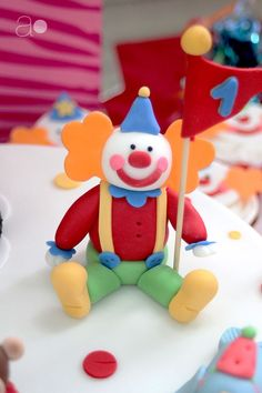 Think this fondant clown is cute? Click to see the rest of the circus cake it's featured on!