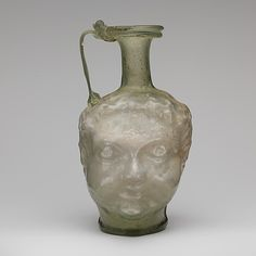 Glass double head-shaped jug 1st half of 4th century A.D. Roman