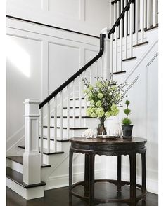 """Everyone of us is looking for """"the stairway""""….Chic foyer opens to a staircase fitted with white spindles and a black railing. Everyone of us is looking for """"the stairway""""….Chic foyer opens to a staircase fitted with white spindles and a black railing. White Staircase, Staircase Remodel, Staircase Makeover, Staircase Railings, Staircase Design, Stairways, Banisters, Staircase Ideas, Stair Spindles"""