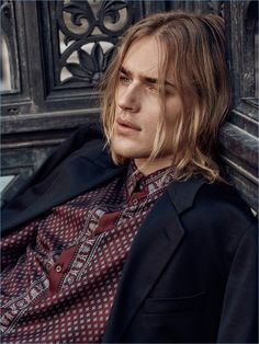 Ton Heukels wears a bandana print shirt and sport coat by Versace.