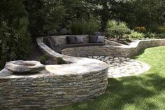 The concept of dry stone walls has been around since agriculture began. No mortar, just gravity. Dry stone walls don't interfere with the natural d. Garden Seating, Outdoor Seating, Backyard Seating, Outdoor Lounge, Front Yard Landscaping, Backyard Patio, Landscaping Ideas, Backyard Ponds, Landscaping Melbourne