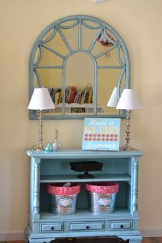 This console table used to be an old floor model tv can you believe it?