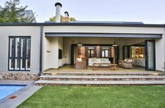 House in a valley is situated in Waterfall Estate, securely enveloped within its context. This home pays homage to environmentally sound principles. Outdoor Spaces, Outdoor Decor, Architect House, Outdoor Entertaining, Backyard Patio, Living Area, Interior Architecture, Modern Farmhouse, Architects