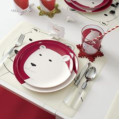 Just a few, artful lines describe the charming contours of a smiling polar bear on this easy-care melamine plate.