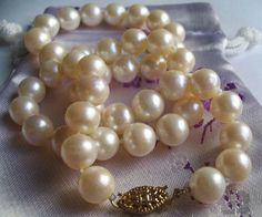 7-7.5mm AAA Gem Quality White, Pink, Mauve or Black Round Pearl Necklace with a 14k Gold Clasp