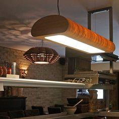 Tube light in oak wood in restaurant La Fonda Middelkerke, Belgium