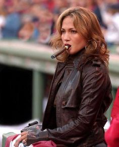 Jennifer Lopez enjoying a smoke at an event. #celebs #cigars