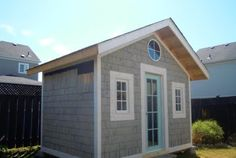 Cute shingled guest house bunkie.