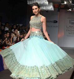 <p>Karisma Kapoor looked as elegant as ever in a Arpita Mehta <em>lehenga</em>. She walked the ramp at Lakme Fashion Week Summer Resort 2014 in a pale blue number with the prettiest mirror work.</p>