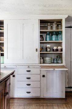A small-space idea: Cut down on cutting boards and counter space by building them in. Here, in a hutch in the main kitchen, boards pull out for chopping and prep, then slide in when not in use.