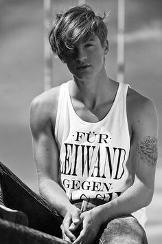 I love this guy as a character omg. Just yes. The messy hair, the shirt, the tattoo <3 you sir are perfect for my book