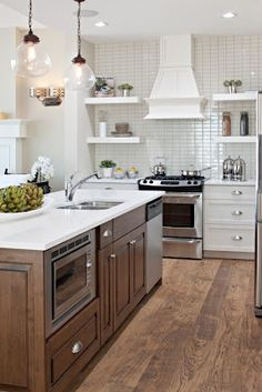 Two-tone kitchen design with white kitchen cabinets, coffee stained kitchen island, & microwave placement Kitchen Island Range, Rta Kitchen Cabinets, White Cabinets, Wood Cabinets, Upper Cabinets, Kitchen Islands, Island Stove, Island Bar, Island Table