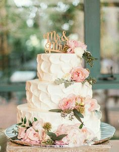 I'd like that way of frosting with plum ribbon and gerbera daisies