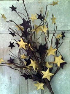 table decor tree branch spray painted with stars glued on