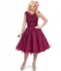 We're always tuned in with tulle, dears! This lush plum frock is a voluminous vintage inspired A-line swing dress
