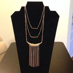 NWOT three tier necklace This necklace has two bar pendants and a fringe pendant. The color is a rose gold tone. The chain measures 20 inches and there is a 3 inch extender. Jewelry Necklaces