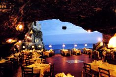 Eat in a cave, overlooking the Sea at Polignano in Puglia Italy (in a hotel called Grotta Palazzese).