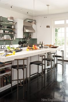 A commercial-grade kitchen boasts sage green subway tiles in Westport, Conn. Photo by John G. Bessler