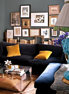Dalla Polvere combines classic antiques with modern art and saturated pops of color in her lovely Spanish home.