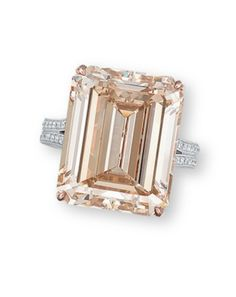 A COLOURED DIAMOND AND DIAMOND RING  Set with a rectangular-shaped fancy light yellowish brown diamond weighing 17.06 carats, to the brilliant-cut diamond stylized gallery, extending to the bifurcated half-hoop, mounted in 18k white and rose gold